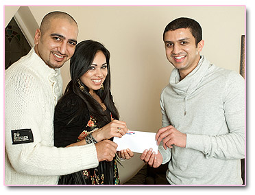Adeem Younis presents Yousaf and Nashina with Umrah tickets.